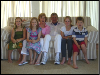 Anne Cawood, with husband Mike and Grandchildren